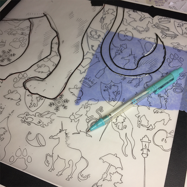 once i have my final feet drawing (Aslan is my first non-human-eque biped!), and have traced the final shapes out of my sketchbook, i use a bit of transfer paper, and re-trace my pattern drawing (created on tracing paper) onto my illustration board so it leaves a light blue line so i know where to paint inside & outside the lines!