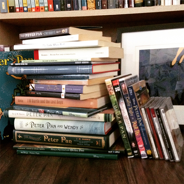 "i collect a fair bit {too much? nah.} of peter pan media. books. illustrated editions. movies. musicals. soundtracks. and more books. here's some of the collection. i also wanted to do a companion piece to my ""wendy loves peter pan."" so i painted peter."