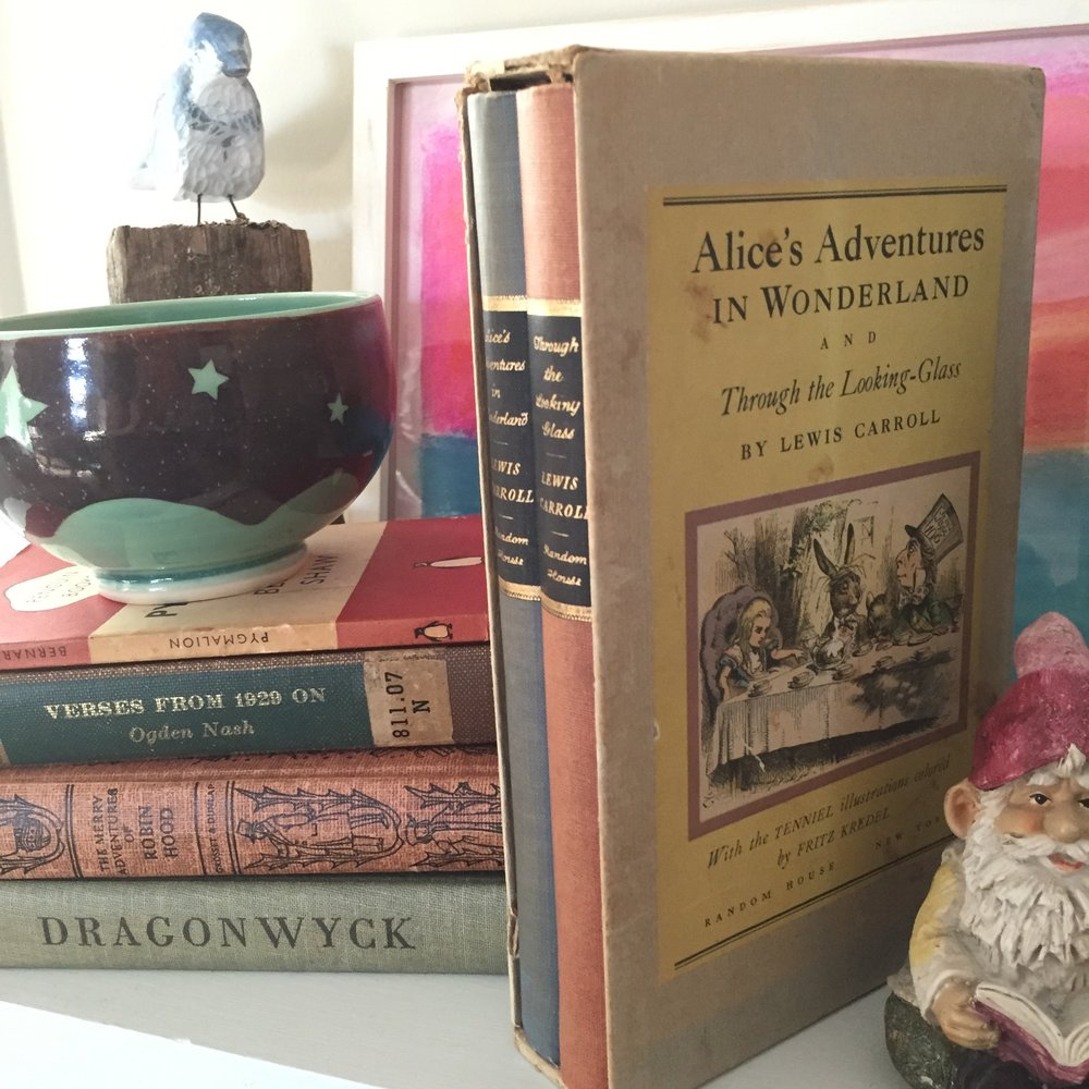 this box set of alice was the START of my antique/unique book collection habits. dad would always drag me to antique stores in watervliet, michigan to shop for tin soldiers, and lo and behold i fell in LOVE with beautiful OLD books. the adventures obviously continue…