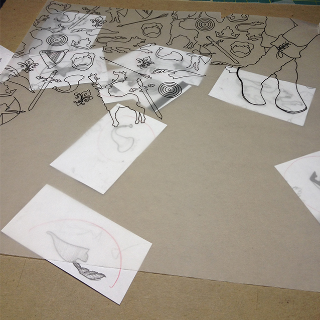 beginning to trace all the icon shapes onto robin's tracing paper to create a full pattern.