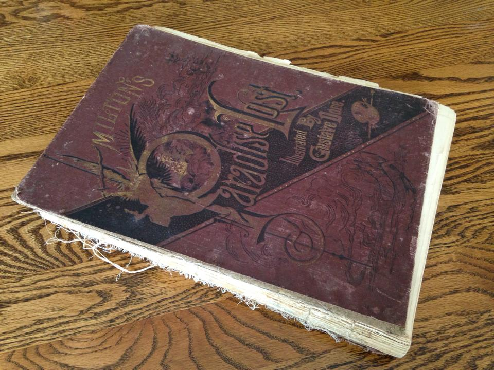 Beat up 19th century edition of Paradise Lost.