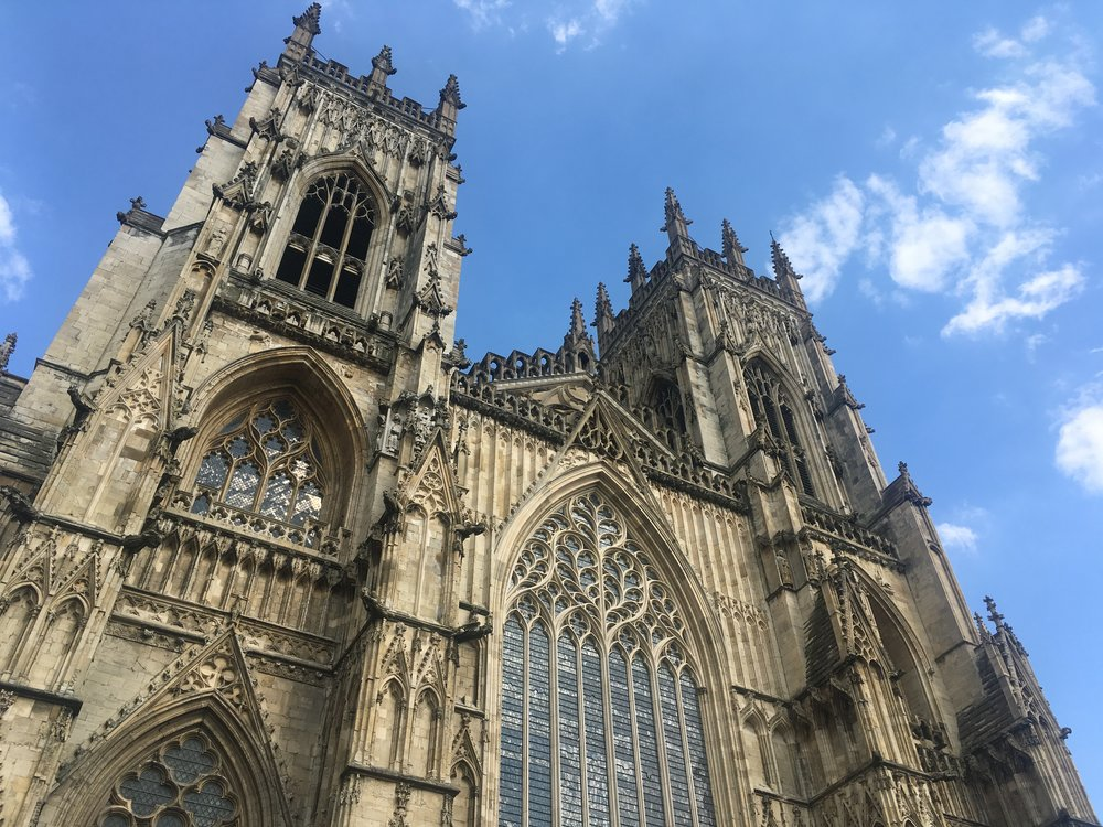 Exterior of York Minster with hundreds of empty niches.