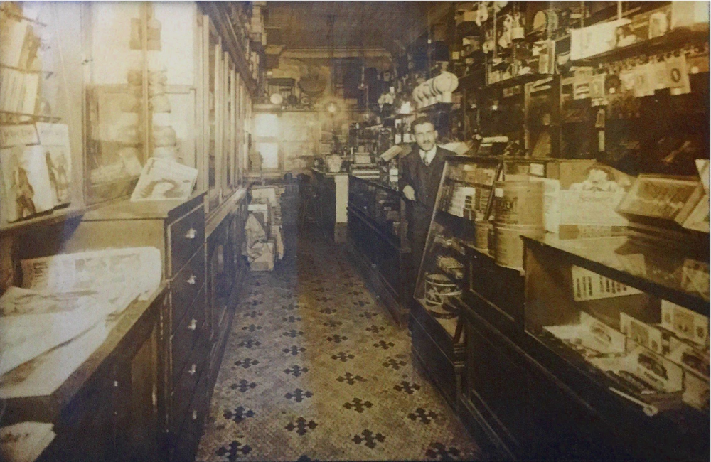 My great-grandfather Simon Mankin in his general store in NYC, 1924  –  soda fountain in the back