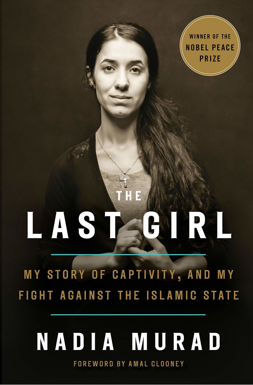 """The Last Girl: My Story of Captivity and my Fight Against the Islamic State - by Nadia Murad""""This year's Nobel Peace Prize winner has published a riveting book that captures how her family and community were ripped apart and follows her devastating but courageous path to reconnect with the remaining family that was not murdered. This book brings awareness to the types of devastation that many women and families still endure.""""- Jennifer D'Avanzo, Senior Project Manager"""
