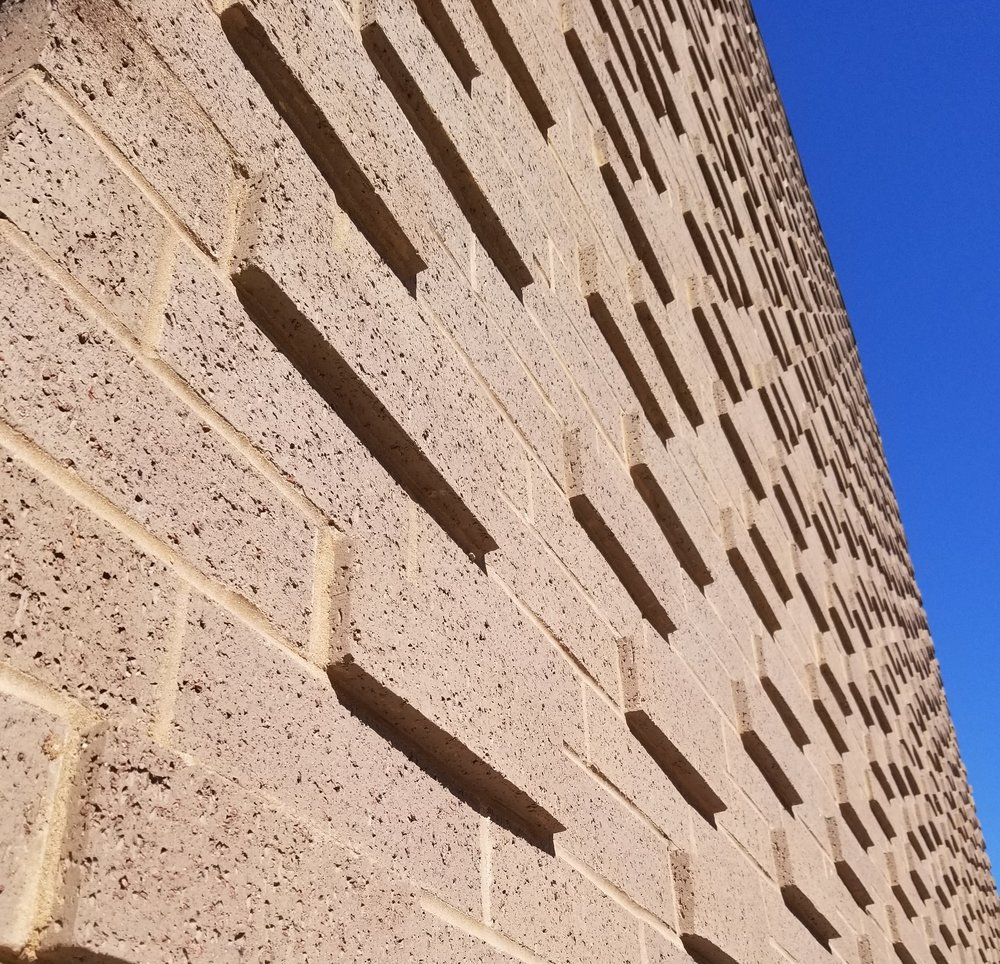 Brick Wall with blue sky cropped (2).jpg