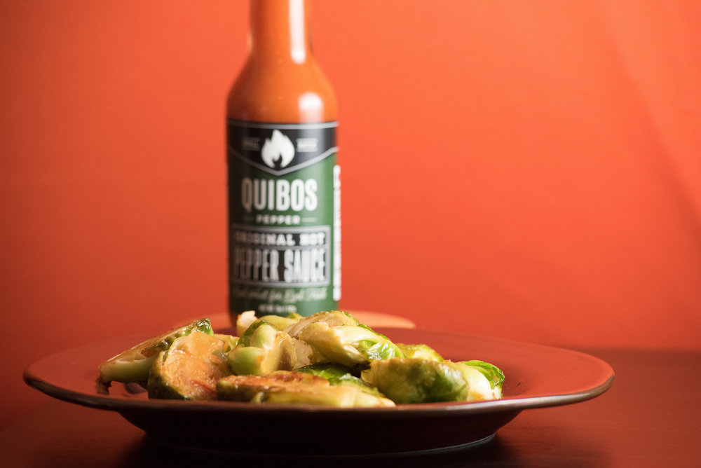 Quibos Pepper Sauce Honey Brussels Sprouts - The spicy and sweet brussels sprouts you've been waiting for.