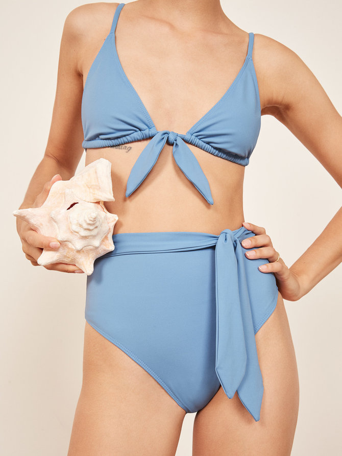 Guava Bikini Top and Papaya Bikini Bottom in Sky by Reformation. Made from recycled Polyamide.