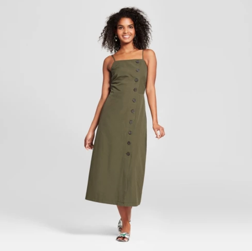 Sleeveless Button-Down Midi Slip Dress - $32.99I have had my eye on this dress for awhile now and I think I am finally going to add it to my collection. Both colors are right on trend, but I feel I can get more use and more seasons out of the olive. This is a chic style for fall paired with a black long sleeve tee, tights, black ankle booties, and a newsboy hat.