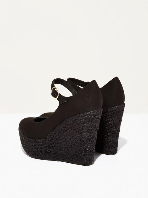 Dolores | Black - $125Another shoe I have added to my collection already. Again, another super tall heel, but the ankle strap definitely helps make these wearable for nights out or short walking distance days. I love the canvas upper with the textured espadrille platform heel.