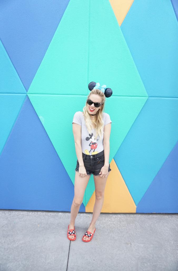 OUTFIT DETAILS C/O: Ears (Shop Disney Parks), Body Suit (Forever 21), Shorts (Express), Slides (Crocs), Sunglasses (Versace), Choker (Express)