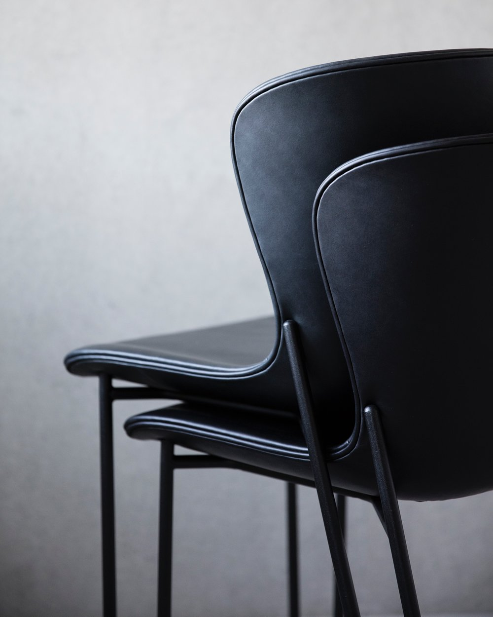 La Pipe Chairs in black stacked