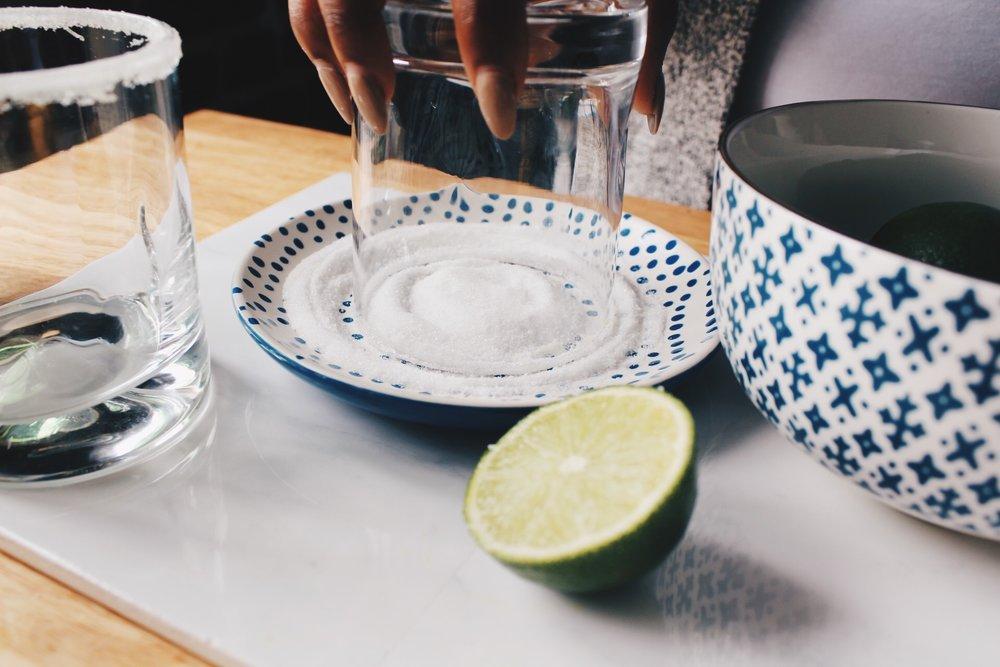 Sugaring the rim of margarita glass