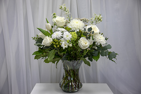 As the large arrangement ages, cut stems shorter.  Break up into smaller vases.  The shortened stem length will extend life of your flowers.   -