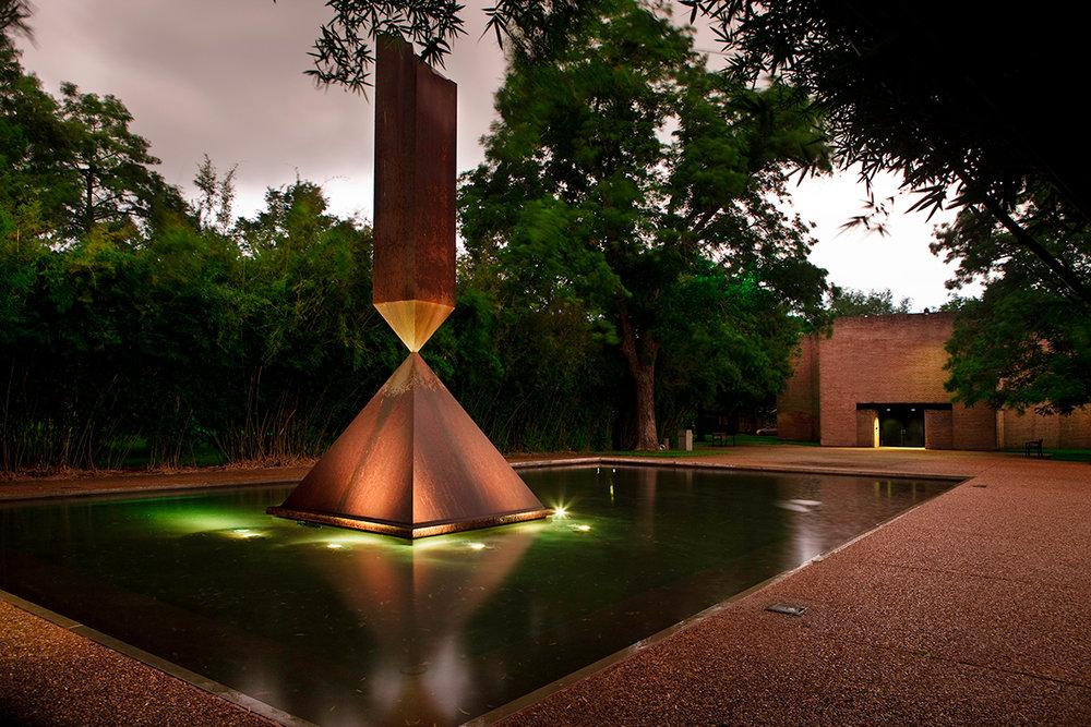 Broken Obelisk by Barnett Newman in front of the Rothko Chapel.