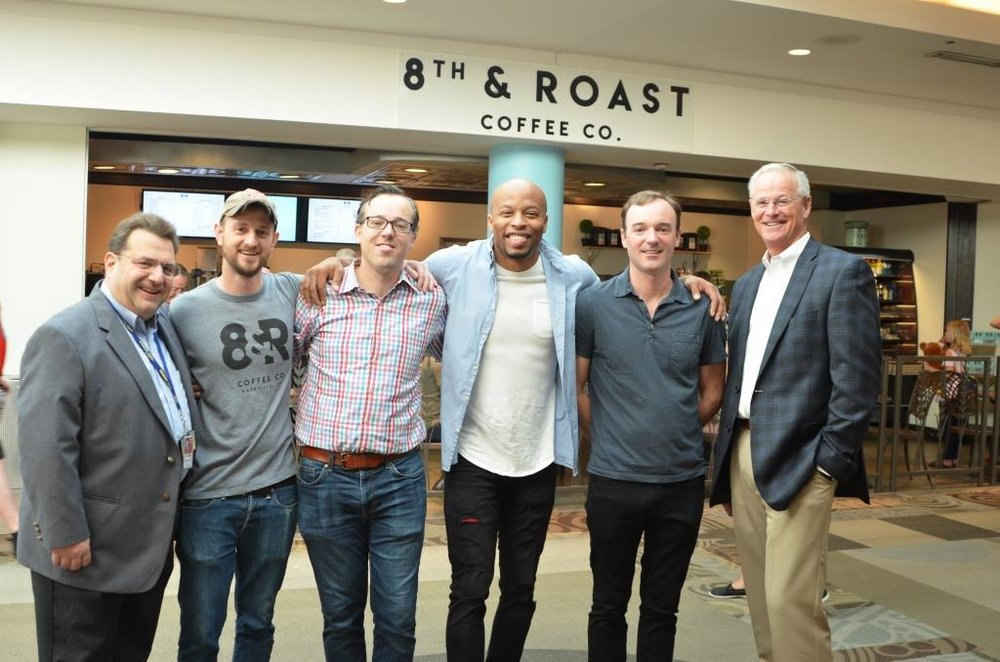 Celebrating the opening, left to right: Jay Greenberg, Senior Director of Operations at Nashville International Airport, HMSHost; David Speegle, Culinary Director, 8th & Roast; Edward Reed, CFO and Owner, 8th & Roast; Q Taylor, Owner, 8th & Roast; Sam Reed, Partner, 8th & Roast; Doug Kreulen, President and CEO, Metropolitan Nashville Airport Authority.
