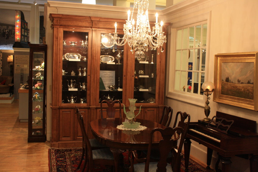 Dining Room exhibit with Eastern Carolina Silver Company silver in case.