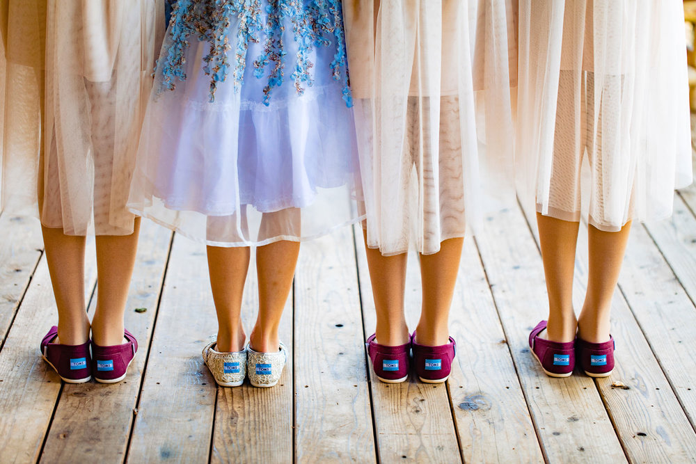 bridesmaids shoes ready for duty as captured by wild basin wedding photographer tomKphoto in allenspark, colorado