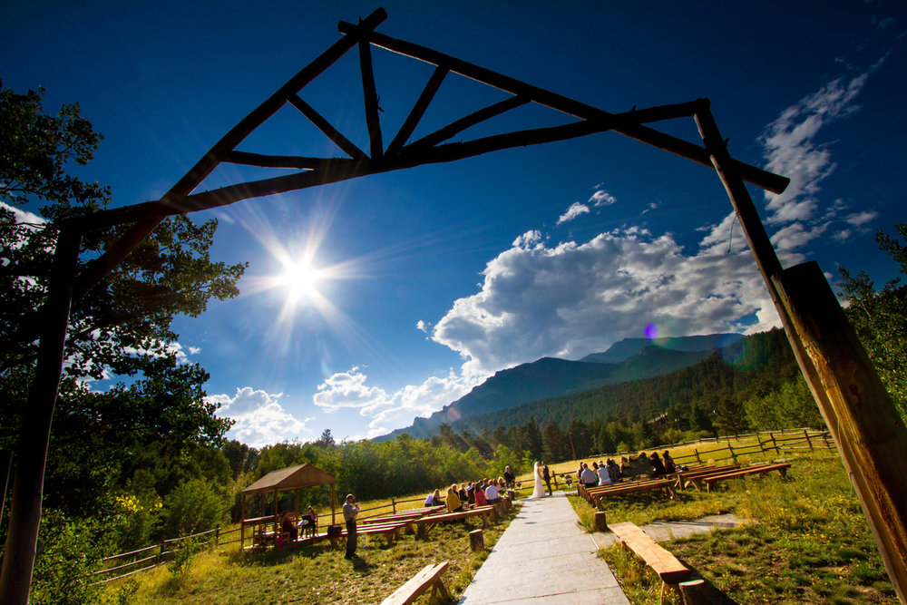 a bright summer day ceremony as captured by tomKphoto, wild basin wedding photographer