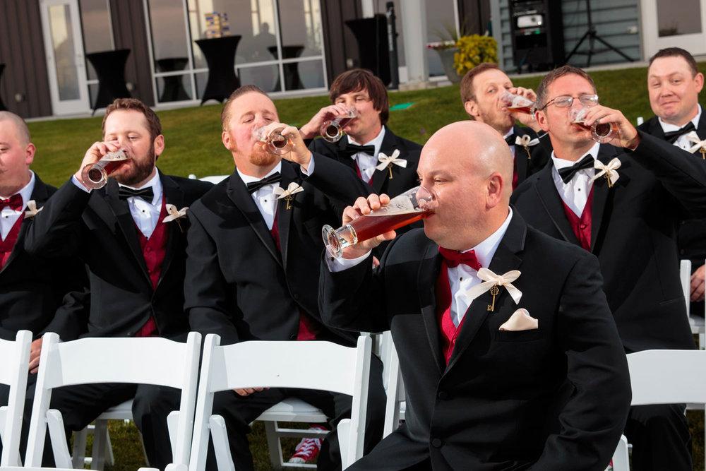groomsmen drinking beer as captured by tomkphoto windsong estate wedding photographer