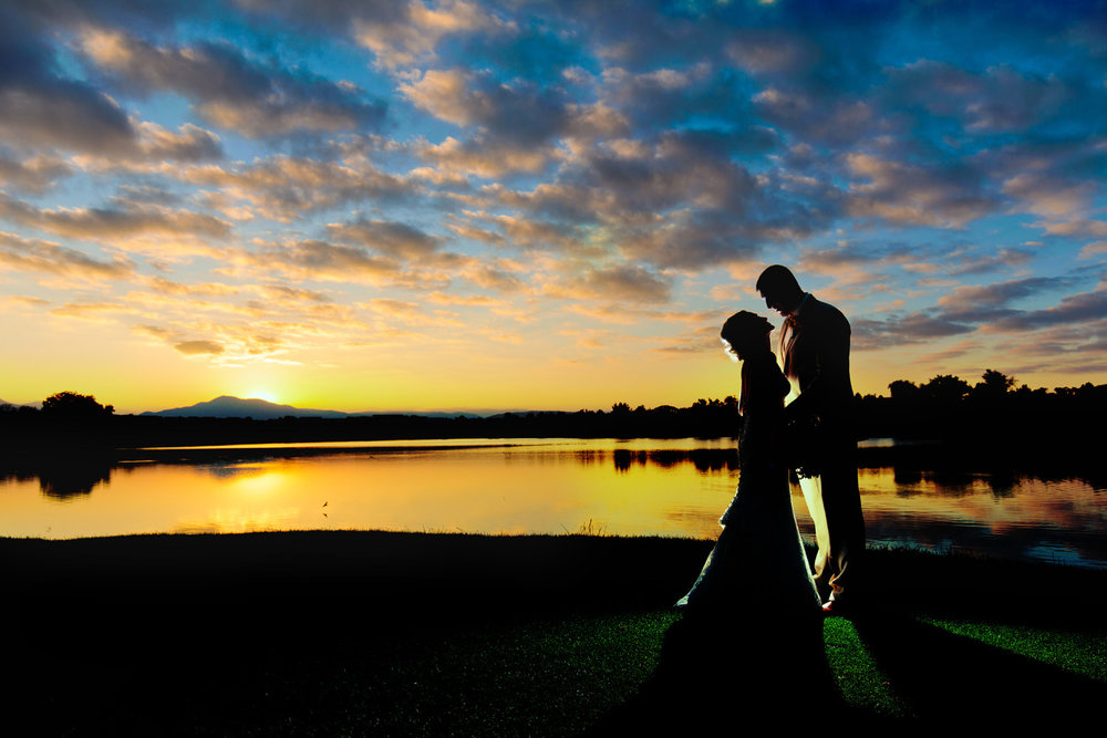 bride and groom enjoy a magical sunset during a barn at raccoon creek wedding in littleton colorado