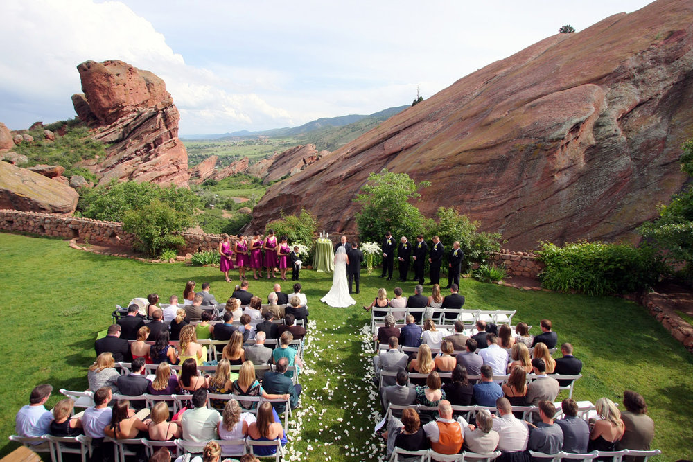 fresh rain storm gives the formations their richest looks during a red rocks wedding in June.
