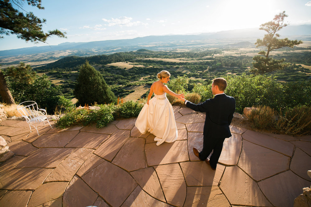 bride and groom practice their first dance in a quiet moment during a cherokee ranch and castle wedding in sedalia, colorado