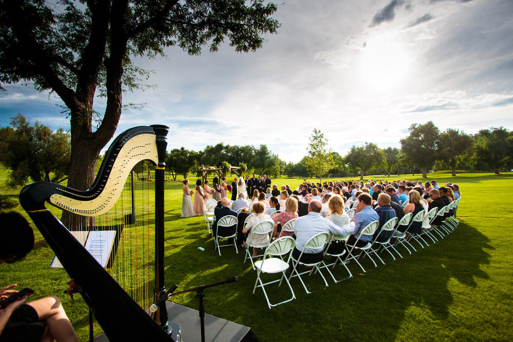 Wide angle ceremony view captured by tomKphoto Lakewood Country Club Denver wedding photographer