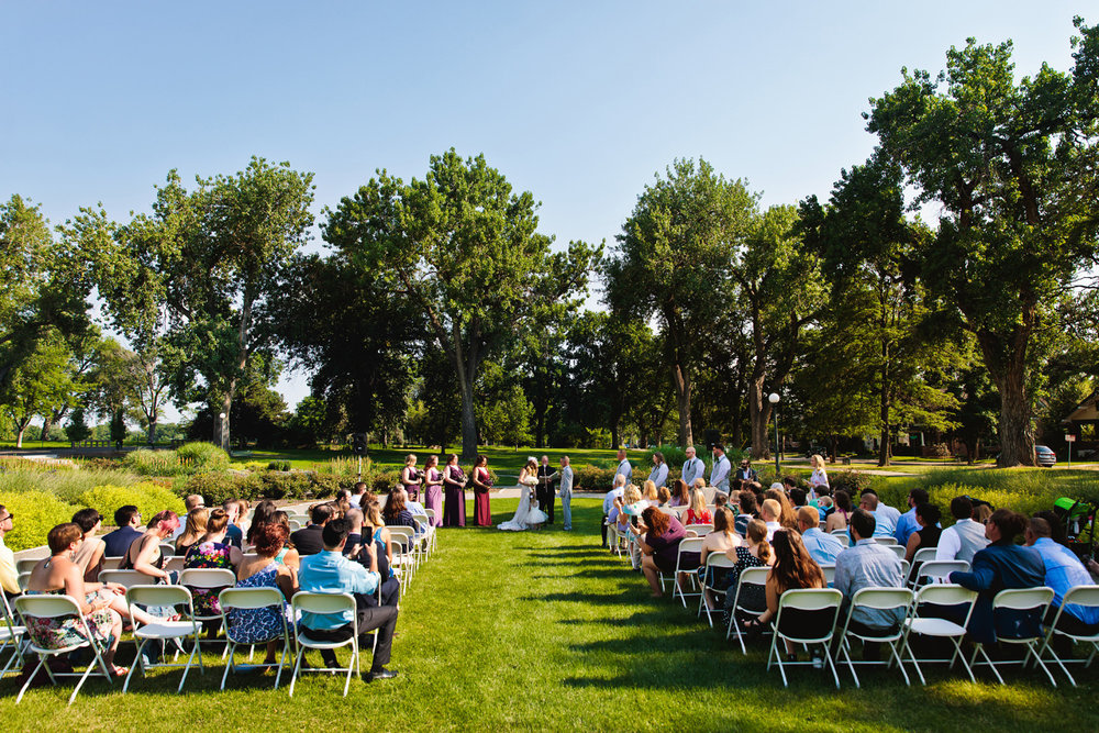 lawn ceremony on summer day during a washington park boathouse wedding in denver, colorado