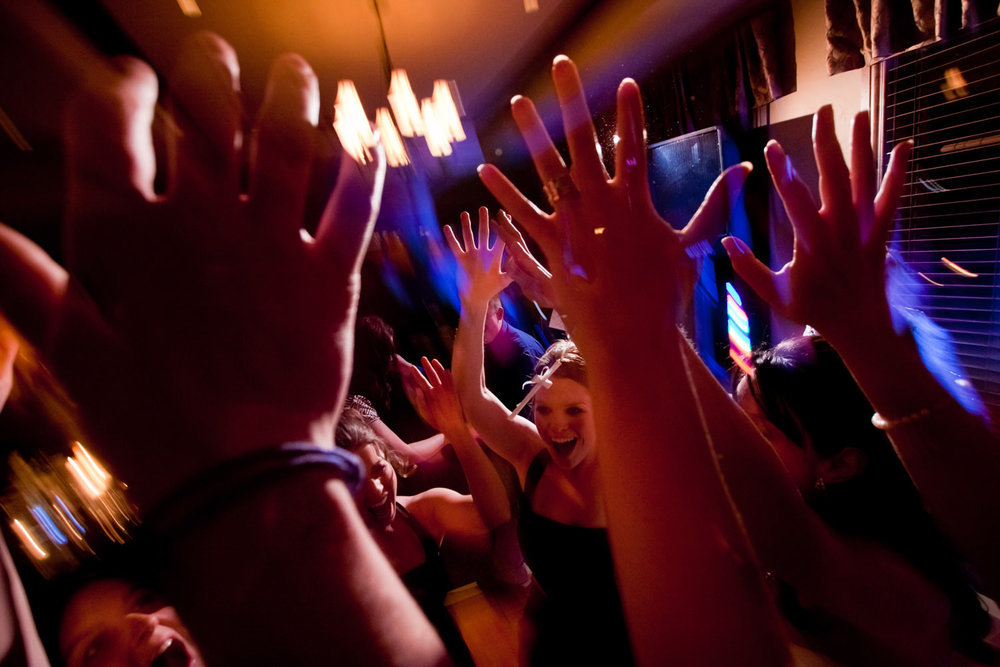 Hands up in the air during a dance party after a Centennial Valley Country Club wedding in Centennial, Colorado