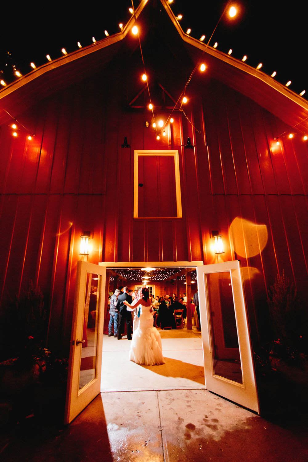 bride parties at her own reception during a denver botanic gardens chatfield farms wedding by tomKphoto