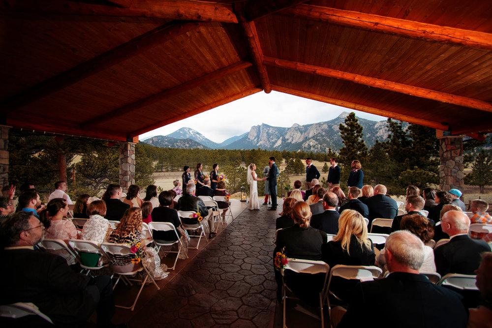 wide ceremony scene during a black canyon inn wedding in estes park, colorado