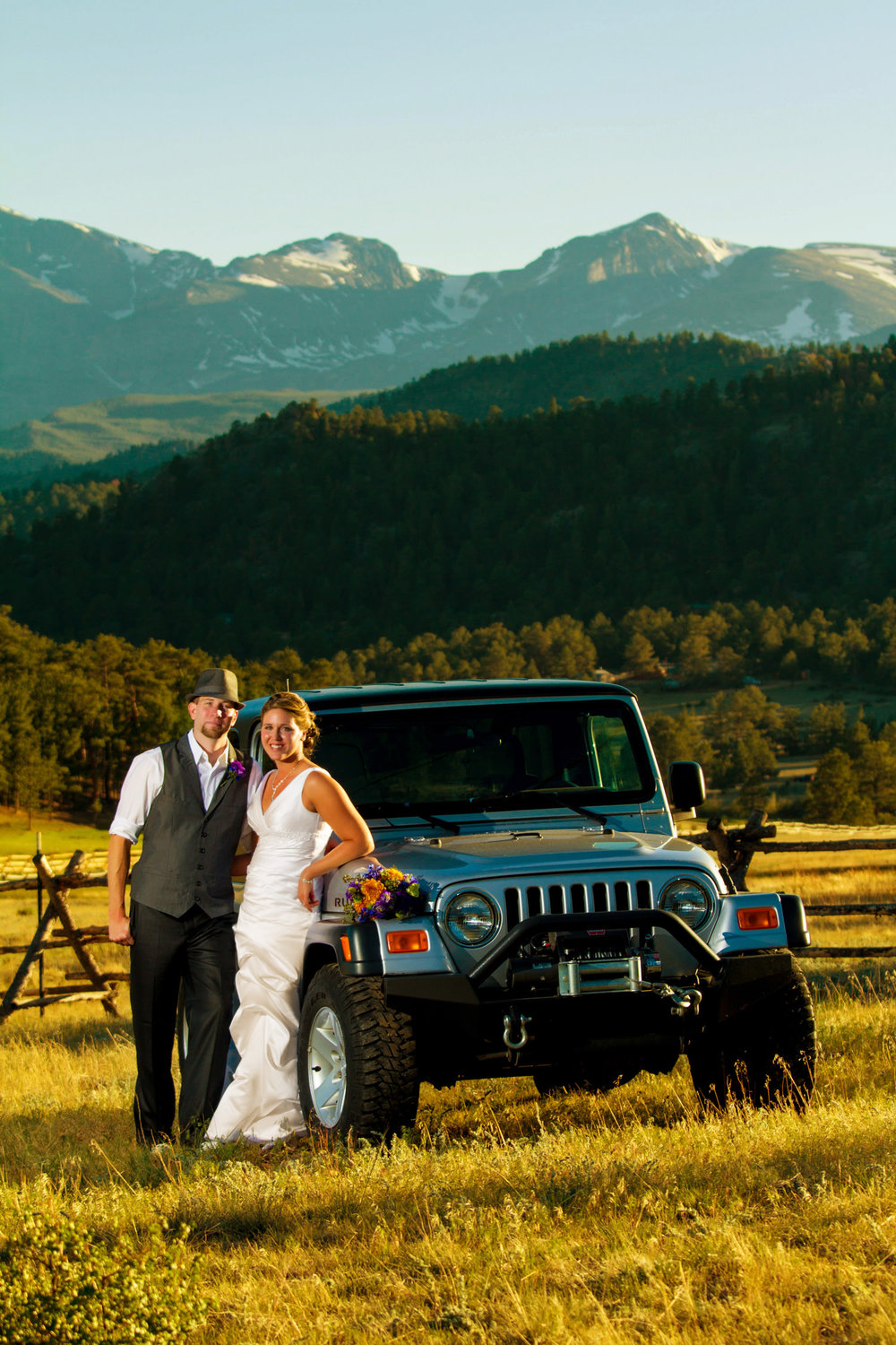 bride and groom with a off road jeep during a black canyon inn wedding in estes park, colorado