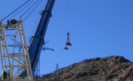 Crane removing 69kV parts