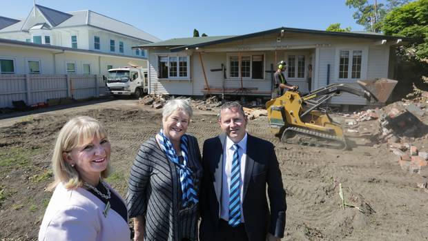 LR Denise Primrose, Harcourts' Jan Mackie, who sold the house and Kaine Wilson, managing director Harcourts Hawke's Bay, with the house as it was prepped for removal. Photo / Warren Buckland