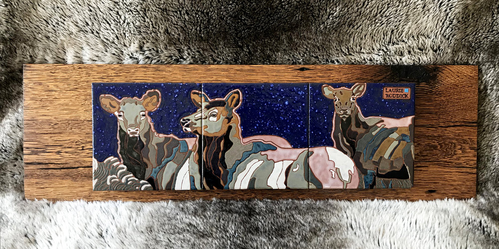 "Snow Maidens ,Ceramic over reclaimed oak,  Size: 22"" W x 8"" H  Price: $750"