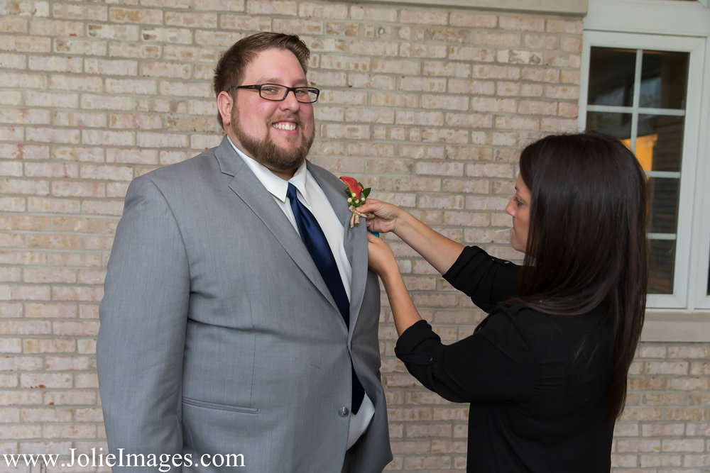 PINNING ON FLOWERS | Photo by:  Jolie Images