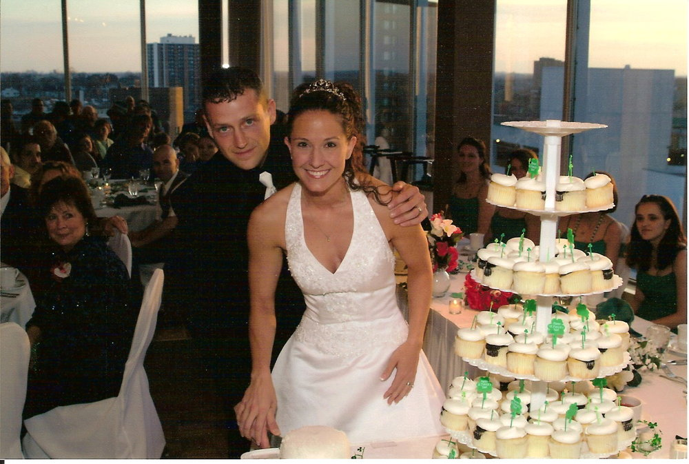 13 Cutting the cake at our wedding.jpg