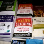 coactive coaching book nestled next to agile texts