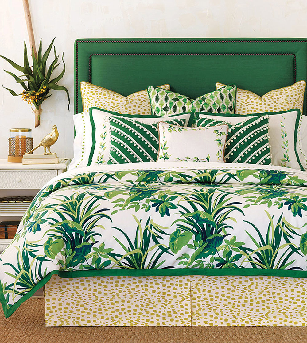 Retro is big—people are looking to old Hollywood for inspiration as shown in this Palm Springs feel bedding and headboard combo in vivid emerald green paired with natural tone animal prints.