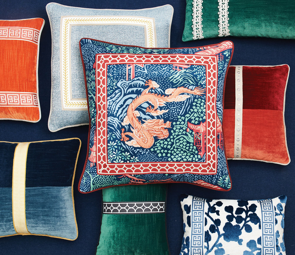 Attention to detail and layered textures are huge trends for 2018 and beyond. These pillows showcase how classic trim and embroidery can take on a modern feel.