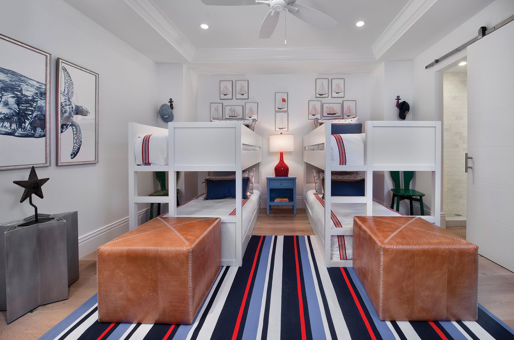 This room is beautifully appointed with nautical art and colors. The perfect place for a fun sleep over, twin bunk beds create plenty of sleeping space. Leather ottomans at the foot of the bed are a durable and fashionable seating option for kid-friendly spaces.