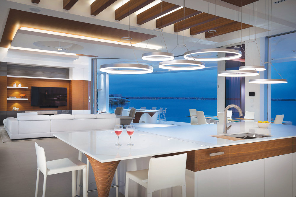 Lighting in your kitchen is vitally important. Not only the color and temperature but also the how the lighting is laid out so there are no shadows and dark zones as you move around the space. LED lighting also allows designers to add decorative options that really create a wow factor.