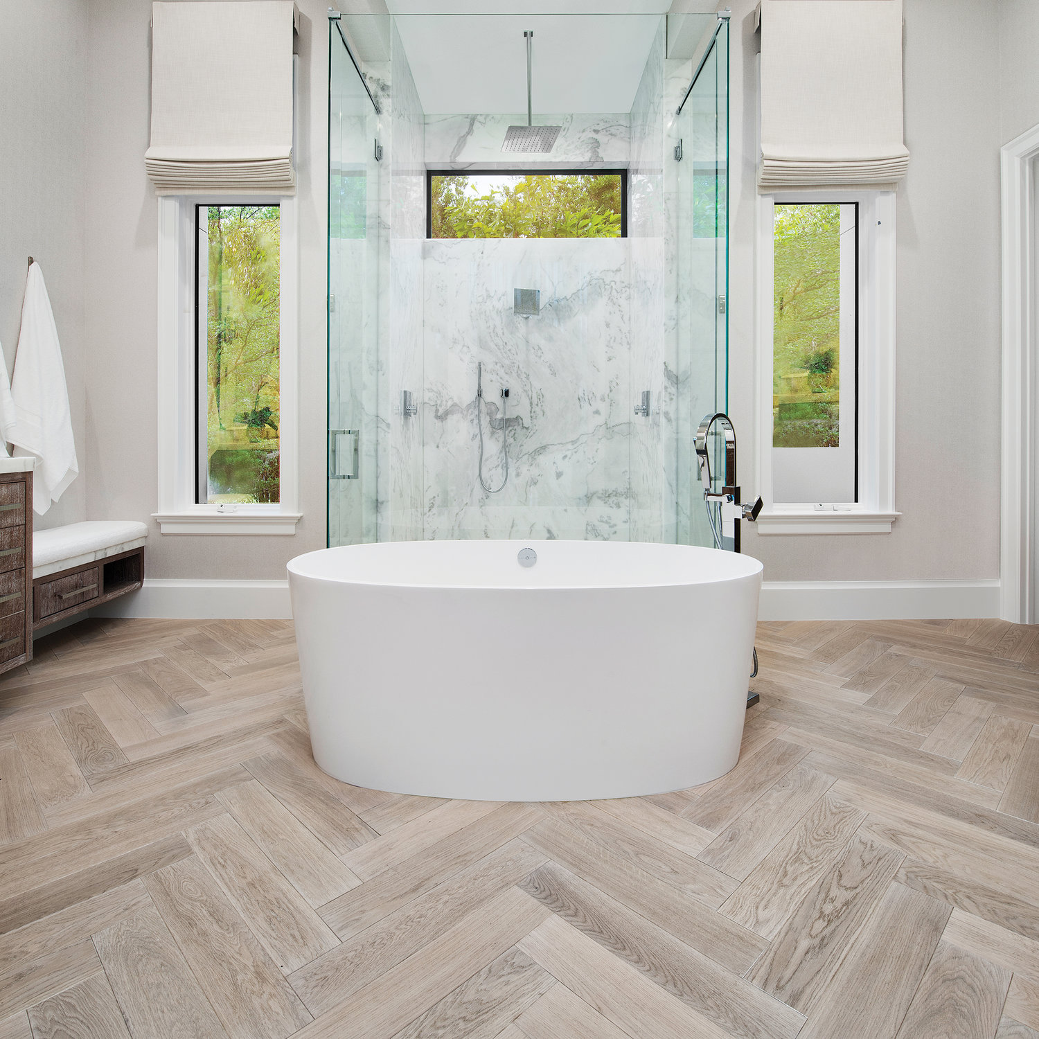 Here, herringbone has been used to create a solid and artistic foundation for this spa-like space. The different angles in this flooring pattern means the tones and colors will change slightly creating movement in the room.