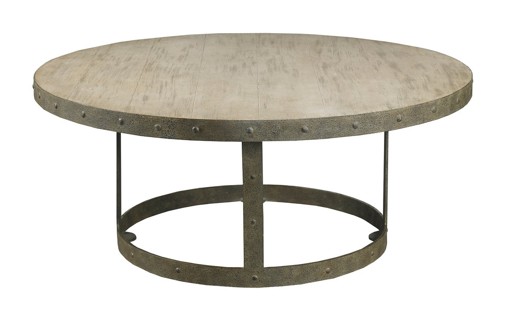 A table with a forged iron base and textured stone top wrapped in studded iron is a great piece for a family-friendly home.