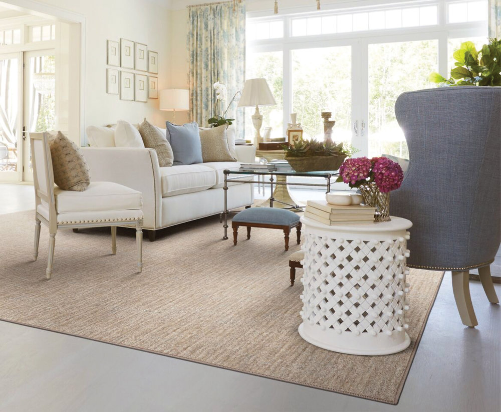The  Lineage II  area rug, from the Stanton Palermo Collection, provides the perfect base layer to add a touch of intimacy to a living room straddling the line between a formal and inviting space