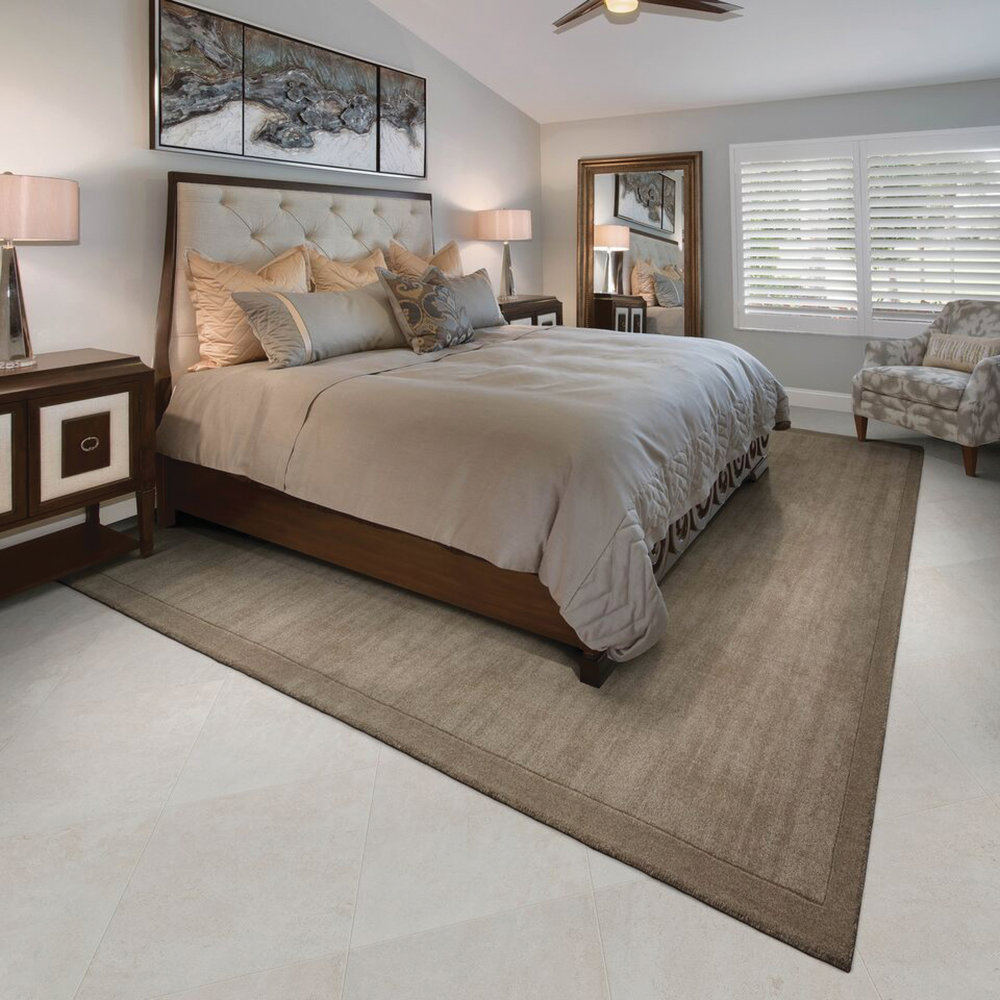 This Stanton Palermo Collection rug,  Earth , with tone-on-tone banding, adds the cohesive element to this soothing guest room.