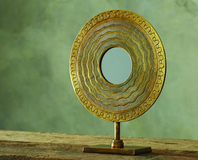Circle table mirror, $169;   arhaus.com