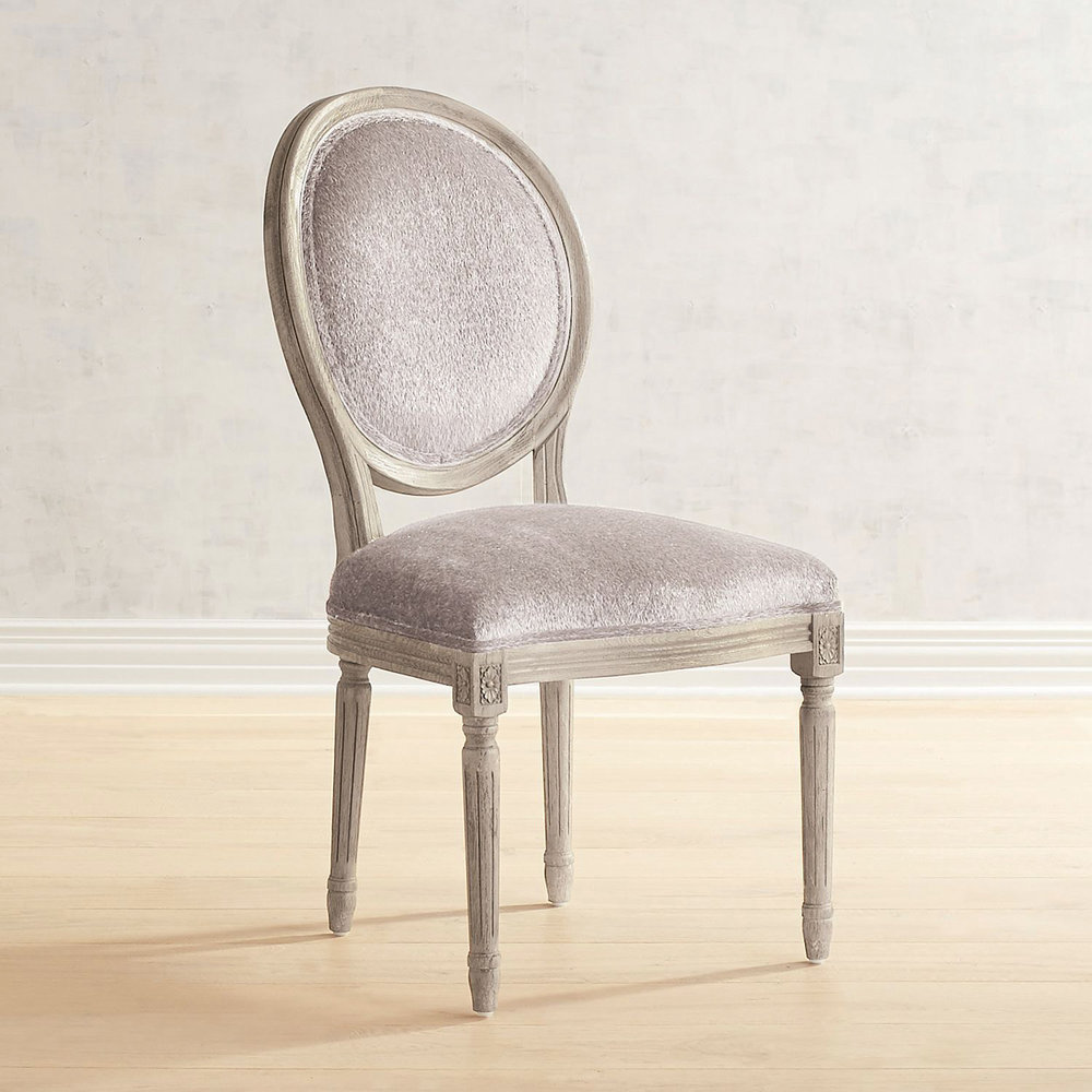 Eliane Collection faux fur silver mink dining chair with gray wash wood, $299.95;   pier1.com