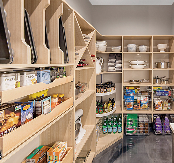 "This pantry combines two popular features—the ""wine x"" storage cubbies and vertical shelf dividers. Pull-out drawers, baskets and Lazy Susans add valuable storage options."