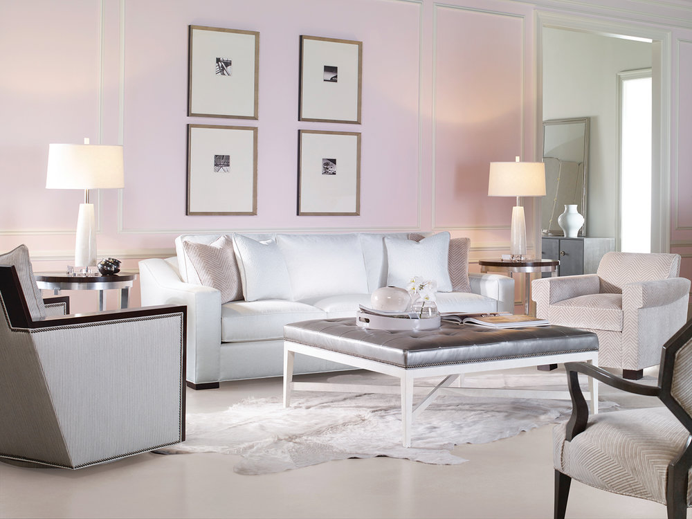 Touches of blush in the chevron-patterned upholstery and matching accent pillows, along with plenty of white, keeps these pink walls from overpowering the serene setting.